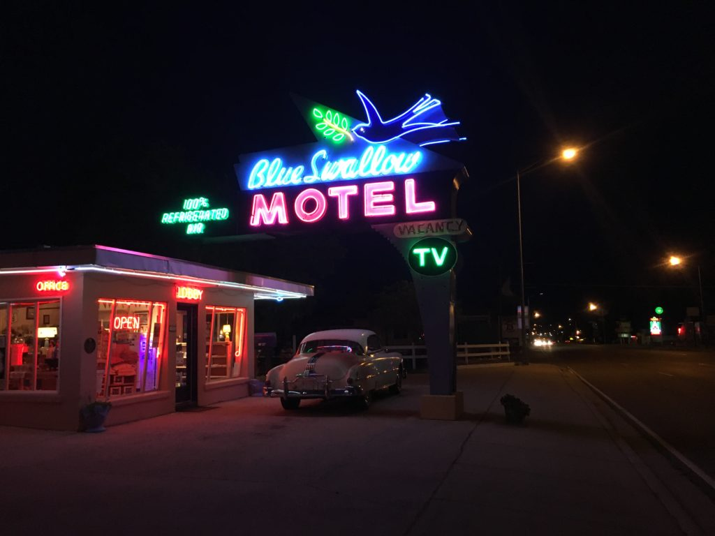 neon sign and front of blue swallow motel tucumcari