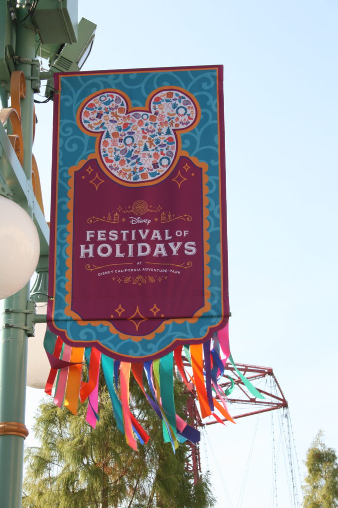 Colorful banner advertising Festival of Holidays in Disneyland.