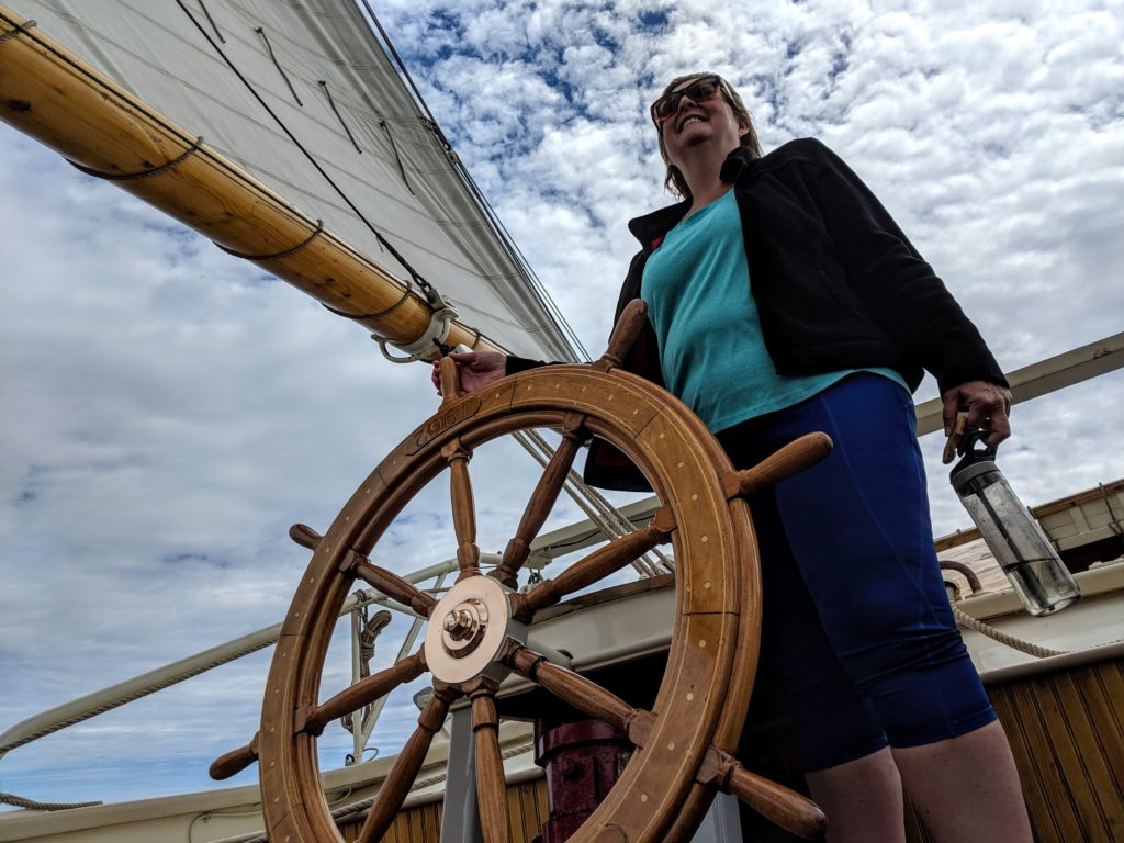 Cindy Richards takes the helm on a Maine Windjammer cruise.