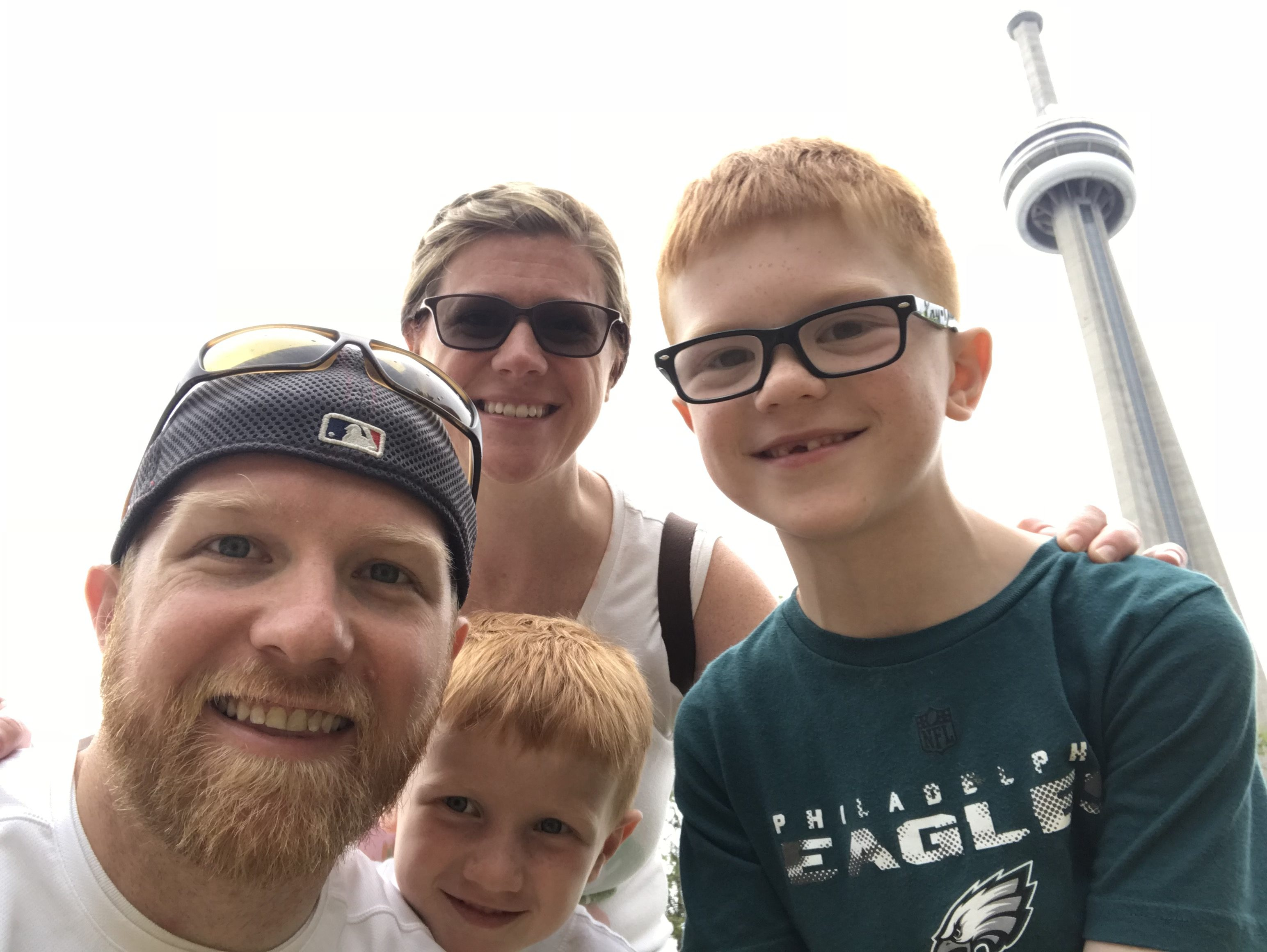 family in toronto in front of CN Tower