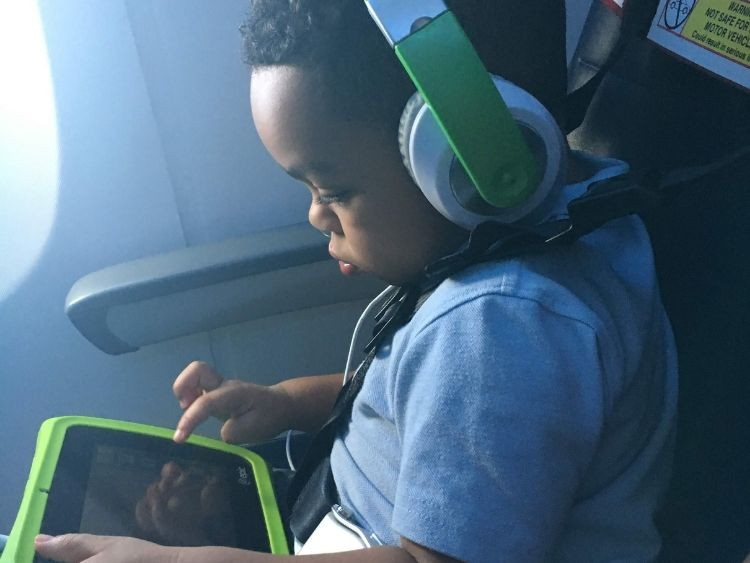 Screen time when flying with a toddler.