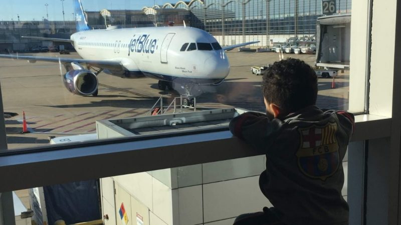 Survival tips for flying with toddlers - toddler at airport.