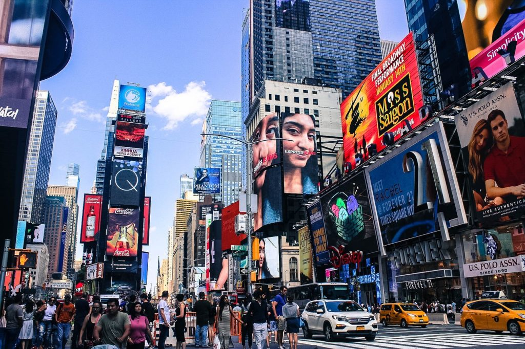 Walk through the hustle and bustle of Times Square, one of the best things to o in NYC with kids.