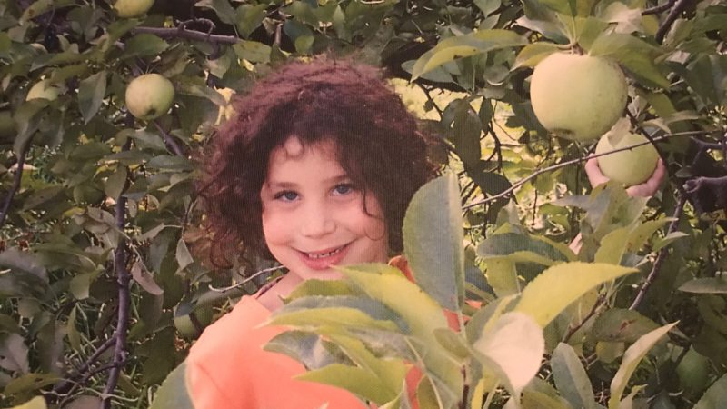 young girl in apple picking orchard near NYC