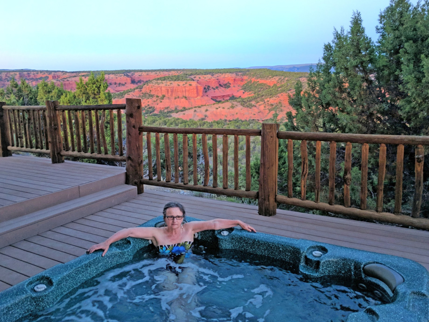 Soaking in a hot tub at the end of the day during dude ranch vacation at Red Reflet.