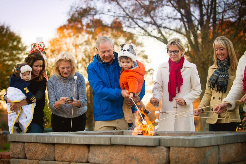 A family making s'mores at the Kingsmill Resort in Virginia.