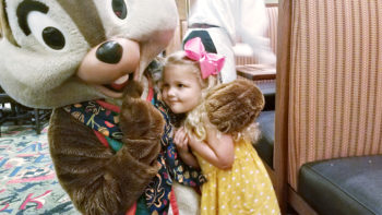 Little girl giving Chip a hug at Mickey's Tales of Adventure Disneyland