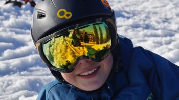 Boy wearing ski goggles.