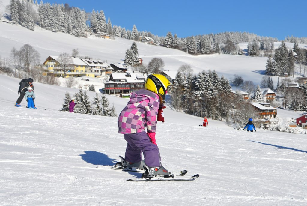 Child learning to ski.