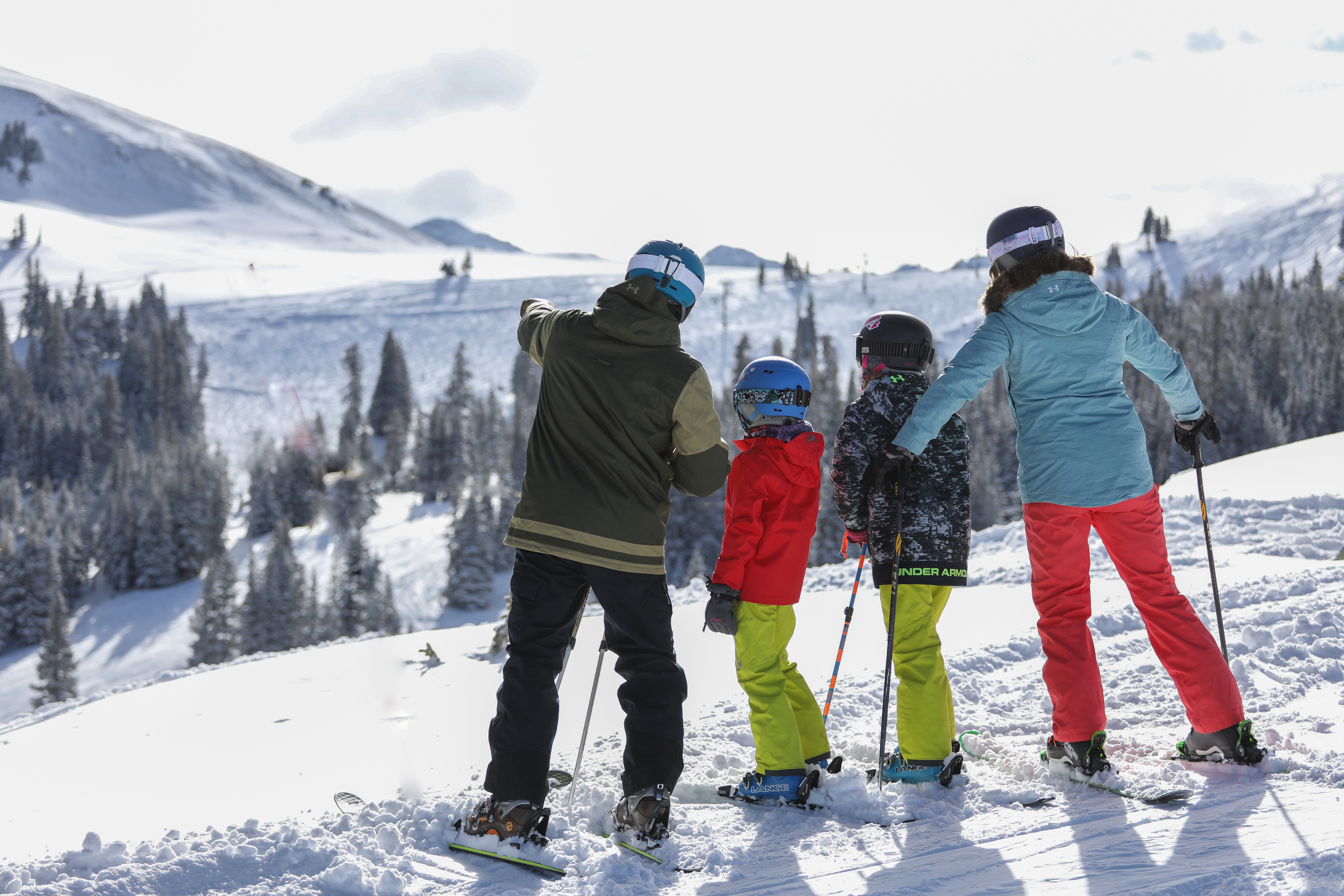 A family skiing at Copper Mountain, one of the best family ski resorts in Colorado