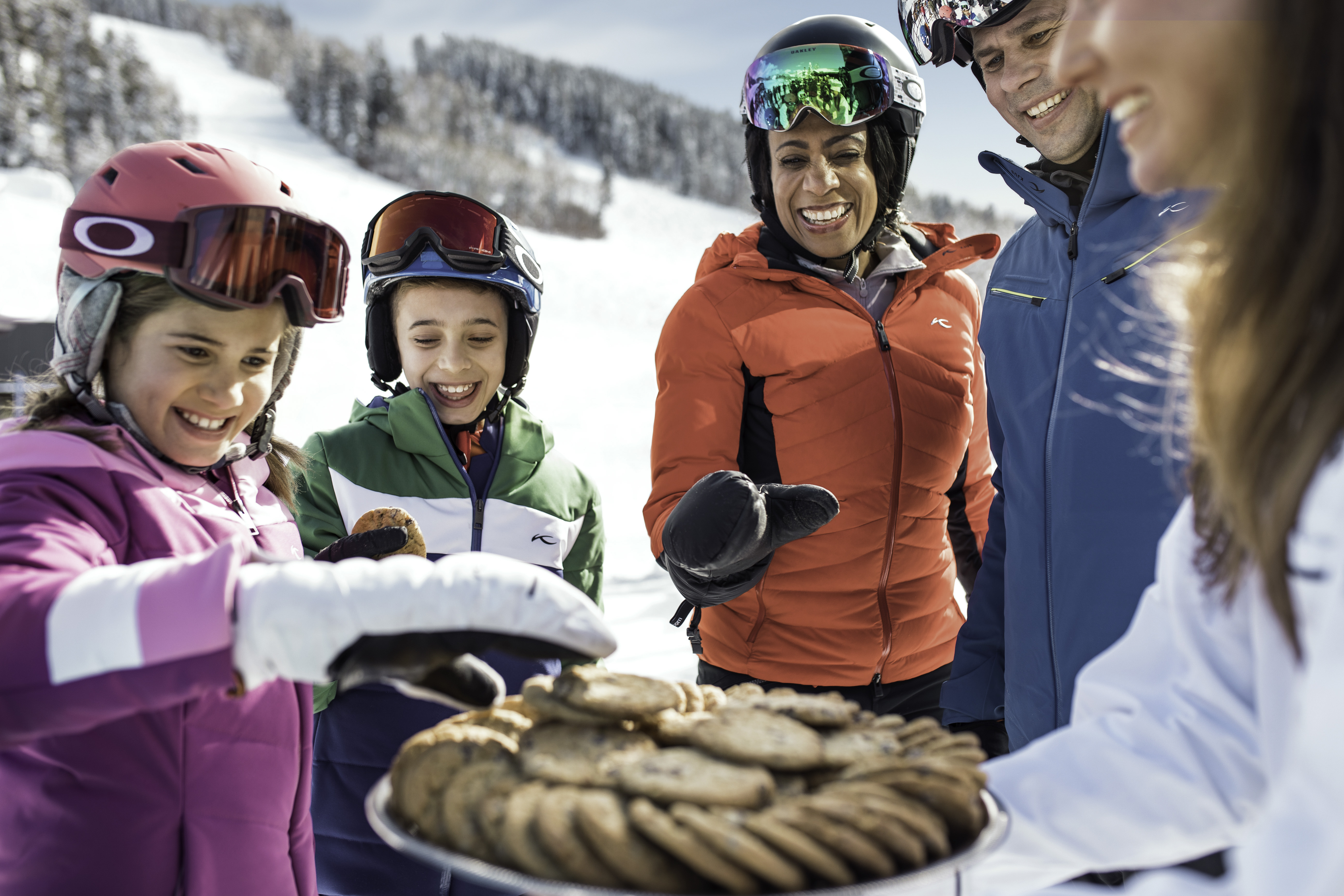 Family of skiers eating cookies in Beaver Creek, one of the best family ski resorts in Colorado