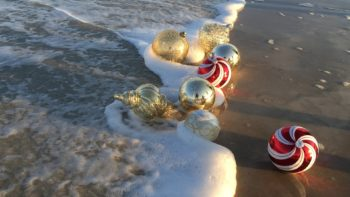 San Diego beach with Christmas ornaments - TravelingMom