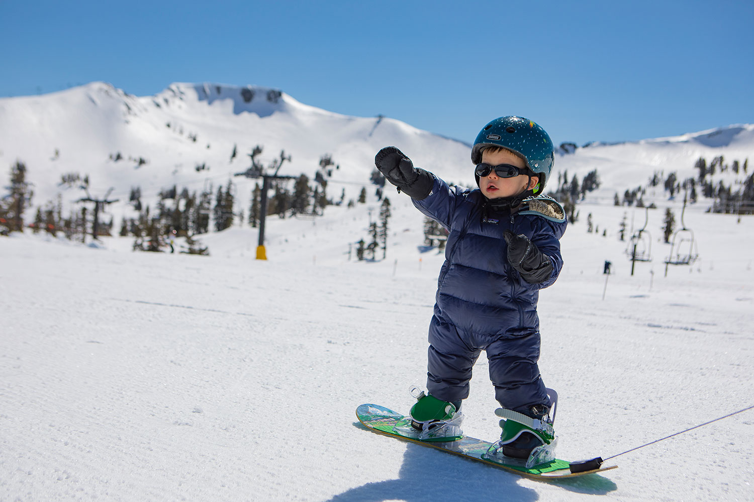 A child learning to snowboard
