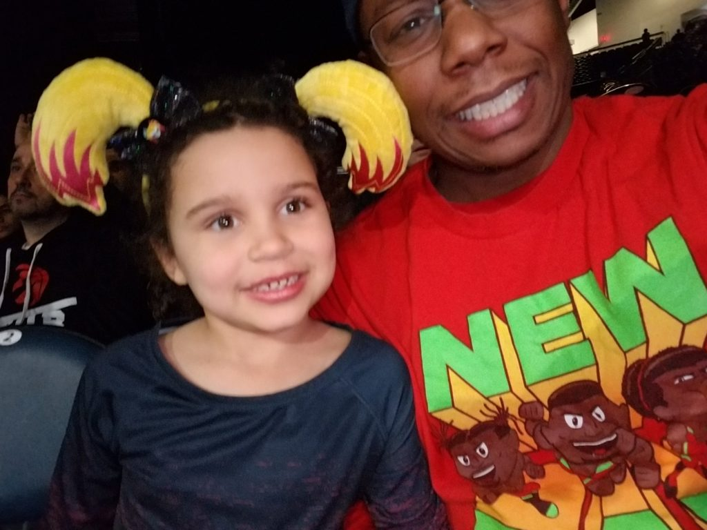 Mike Armstrong and his daughter at a WWE event