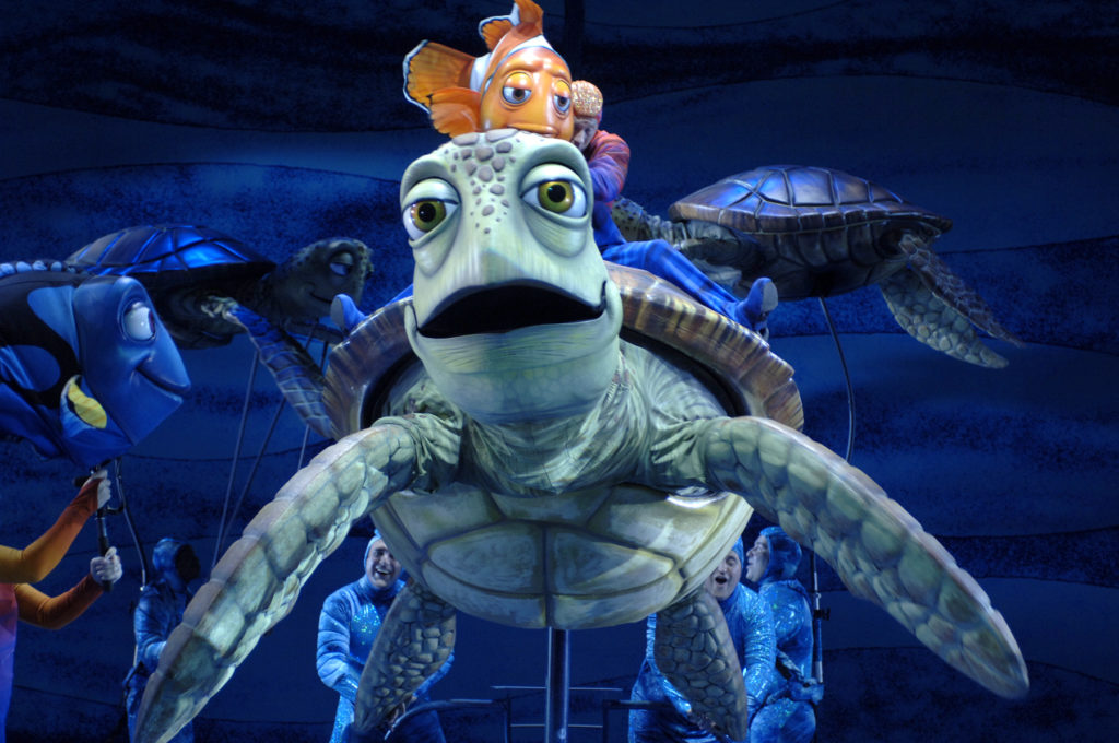 """Finding Nemo — The Musical,"" This production features the theatrical puppetry of Michael Curry, who co-created the richly designed puppets seen in the Broadway version of ""Disney's The Lion King."" Some puppets are larger than life — such as Crush, the cool sea turtle who is nearly the size of a Volkswagen. Photo Credit: Walt Disney World"