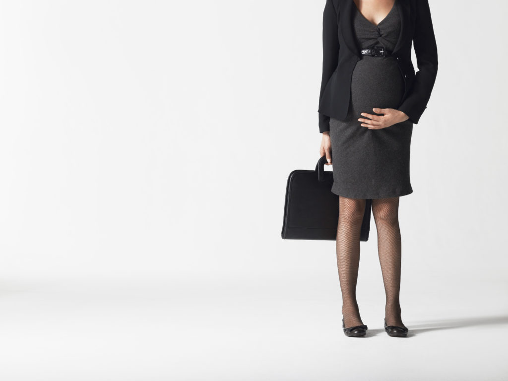 pregnant business traveler