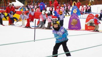 child skiing wearing helmet