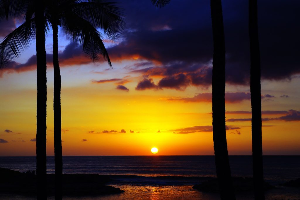 See a gorgeous sunset on Hawaii family vacation.