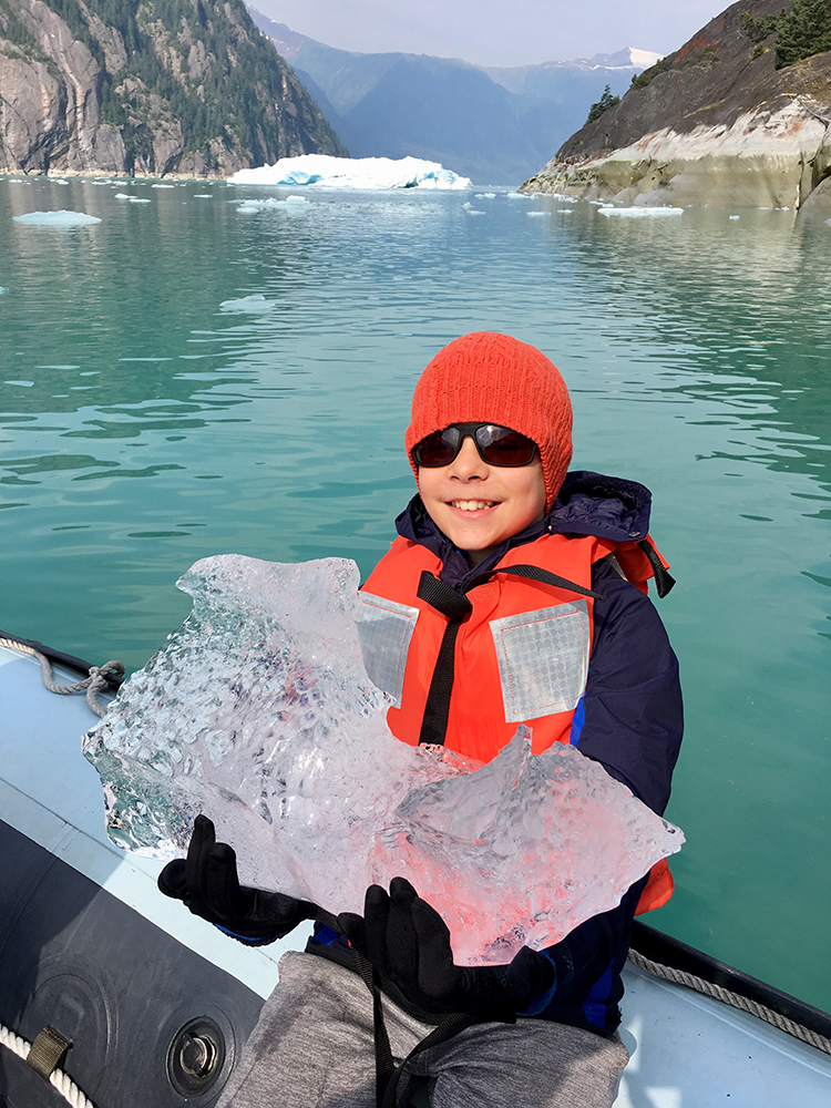 Picking up small icebergs from the water on an Uncruise Alaska trip.