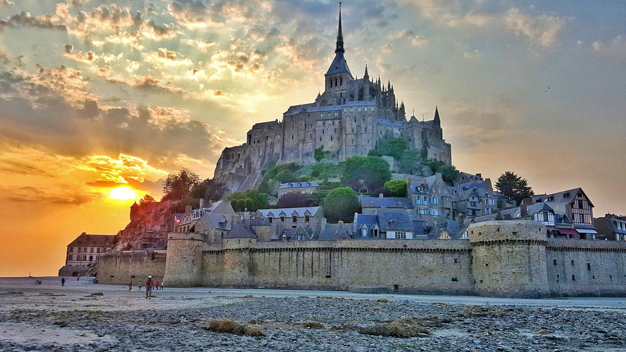 Mont St. Michel at sunset, a Disney real life location - TravelingMom