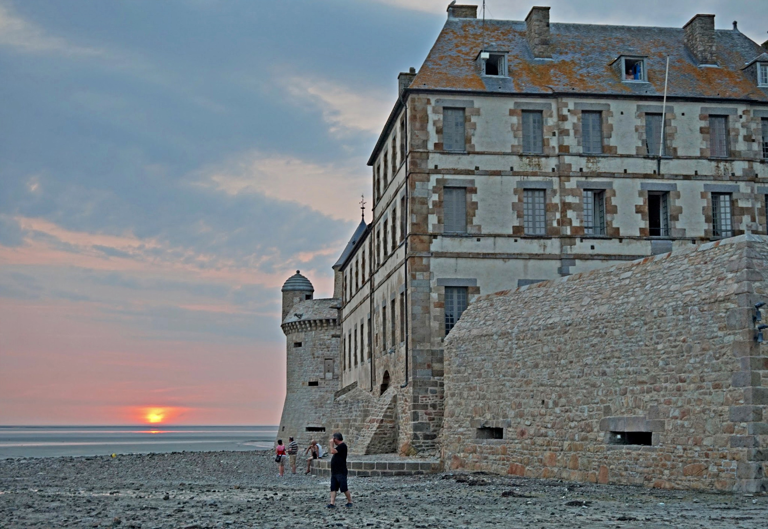 Sunset at the foot of Mont Saint Michel – photo by Yvonne Jasinski