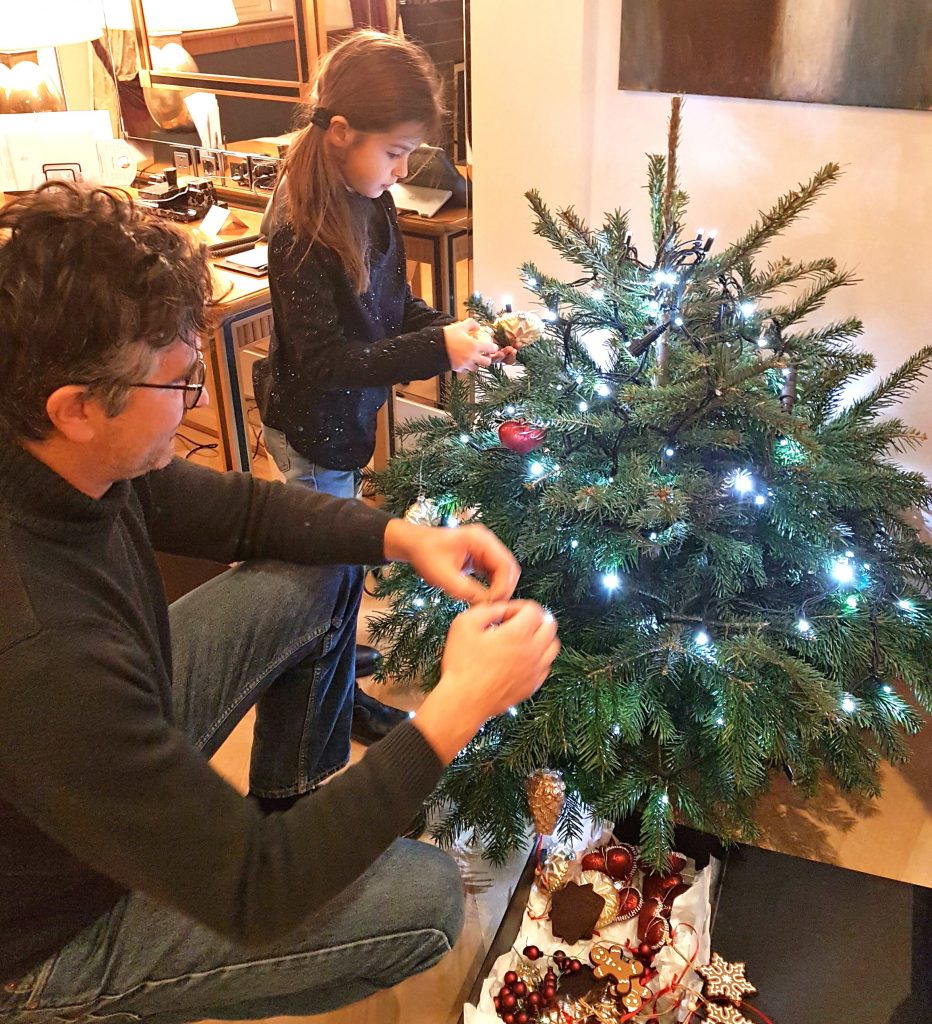 Decorating a live Christmas tree in a Beau Rivage hotel room in Bern, Switzerland.