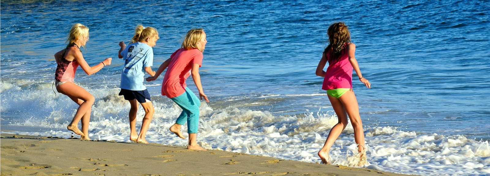 Kids playing in the waves of he Pacific Ocean