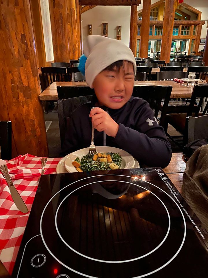 Young boy making a face while eating - travelingmom