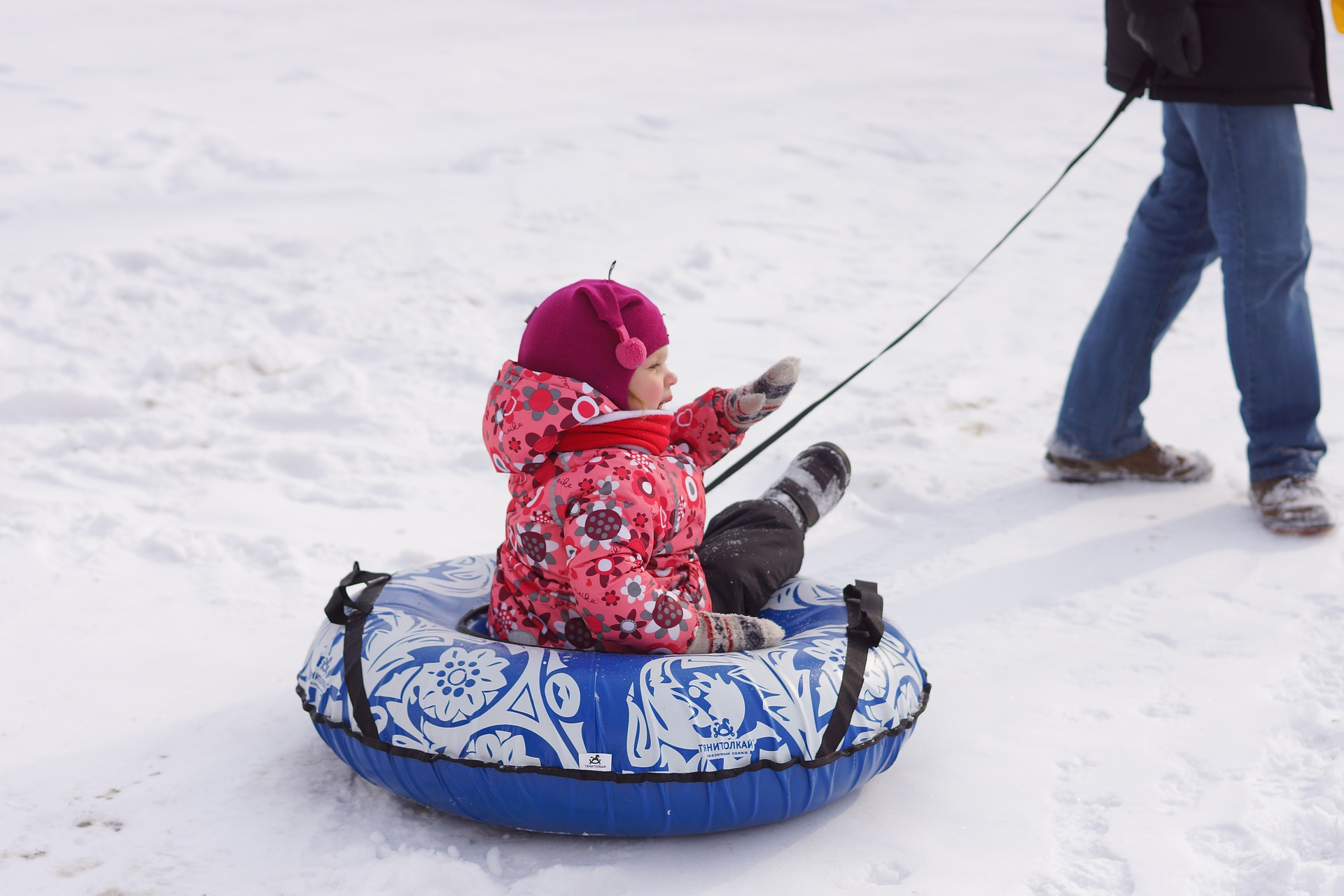 Wrap your toddler up in scarfs and hats to keep her warm in the winter.