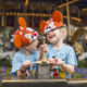 two boys in Mickey Mouse ears at Disney - TravelingMom