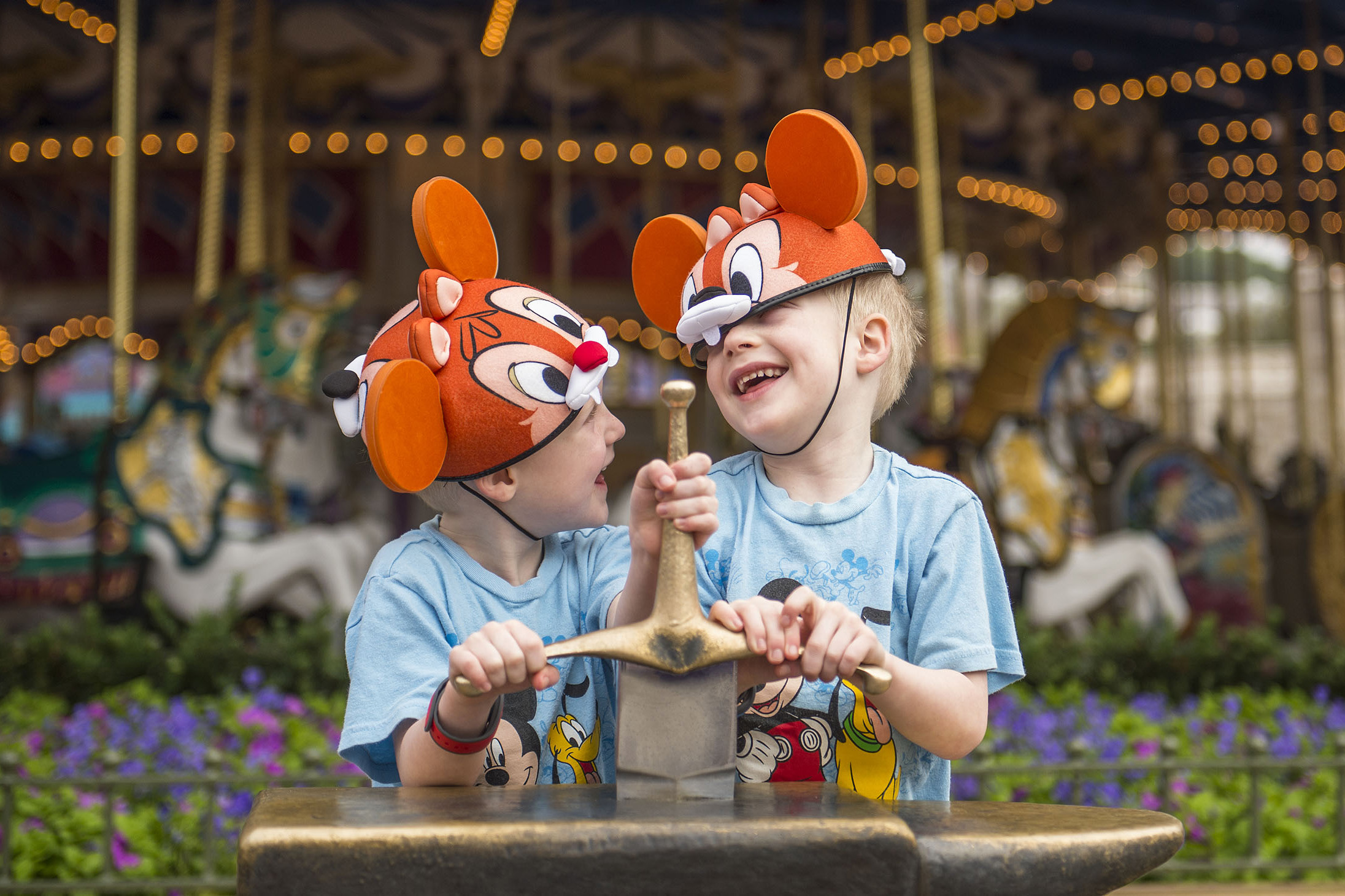 two boys in Mickey Mouse ears at Disney