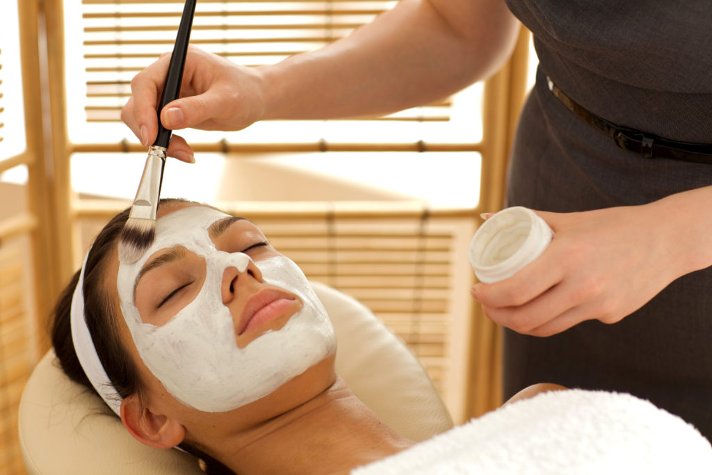 woman enjoying a painted on facial at a spa gift experiences