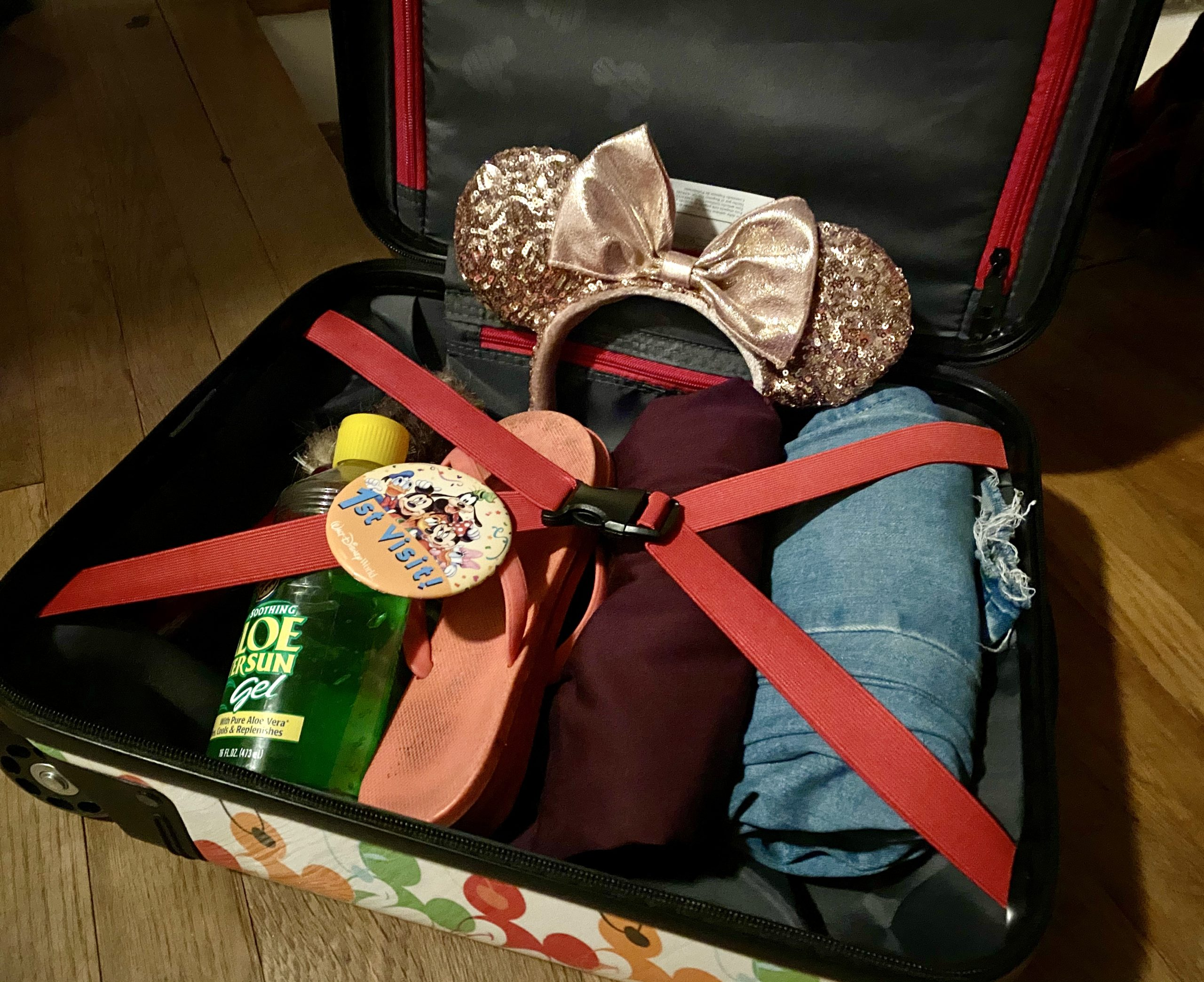 suitcase packed for a Disney World vacation - travelingmom