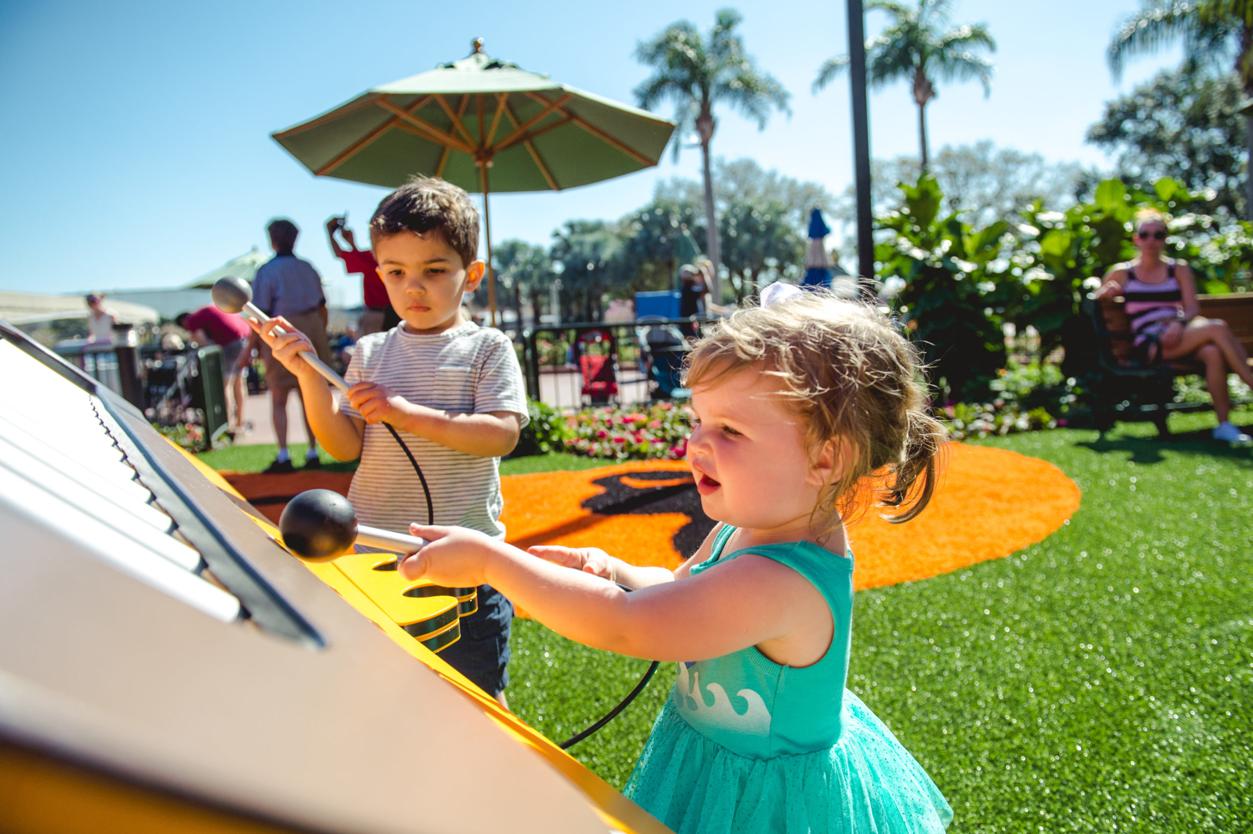 Toddlers playing instruments in Disney World