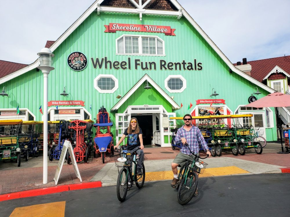 Two young adults on bicycles at Wheel Fun Rentals in Long Beach - TravelingMom