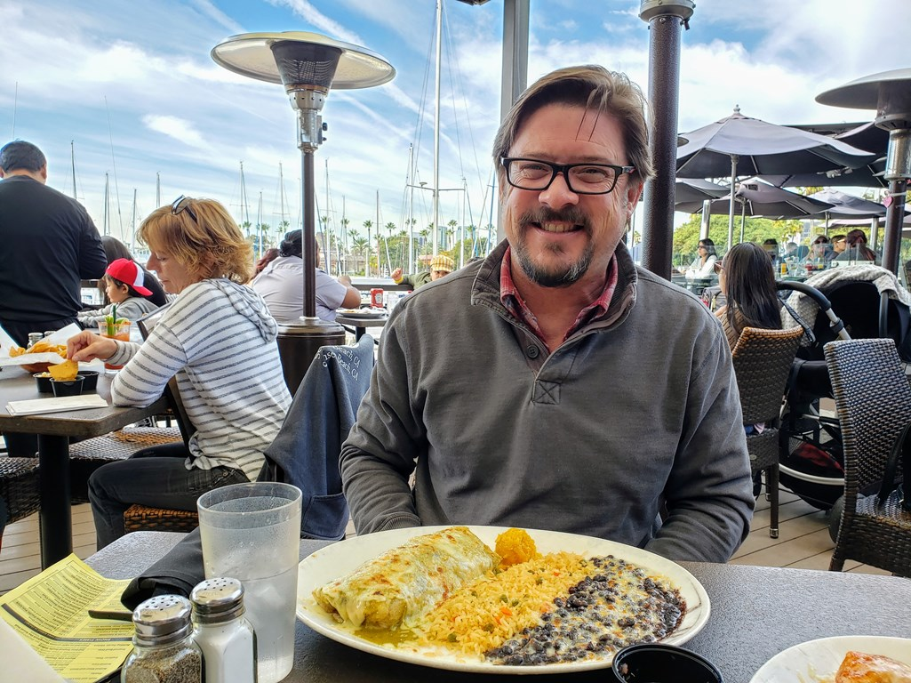 Man with plate of food at Tequila Jack's in Long Beach - TravelingMom