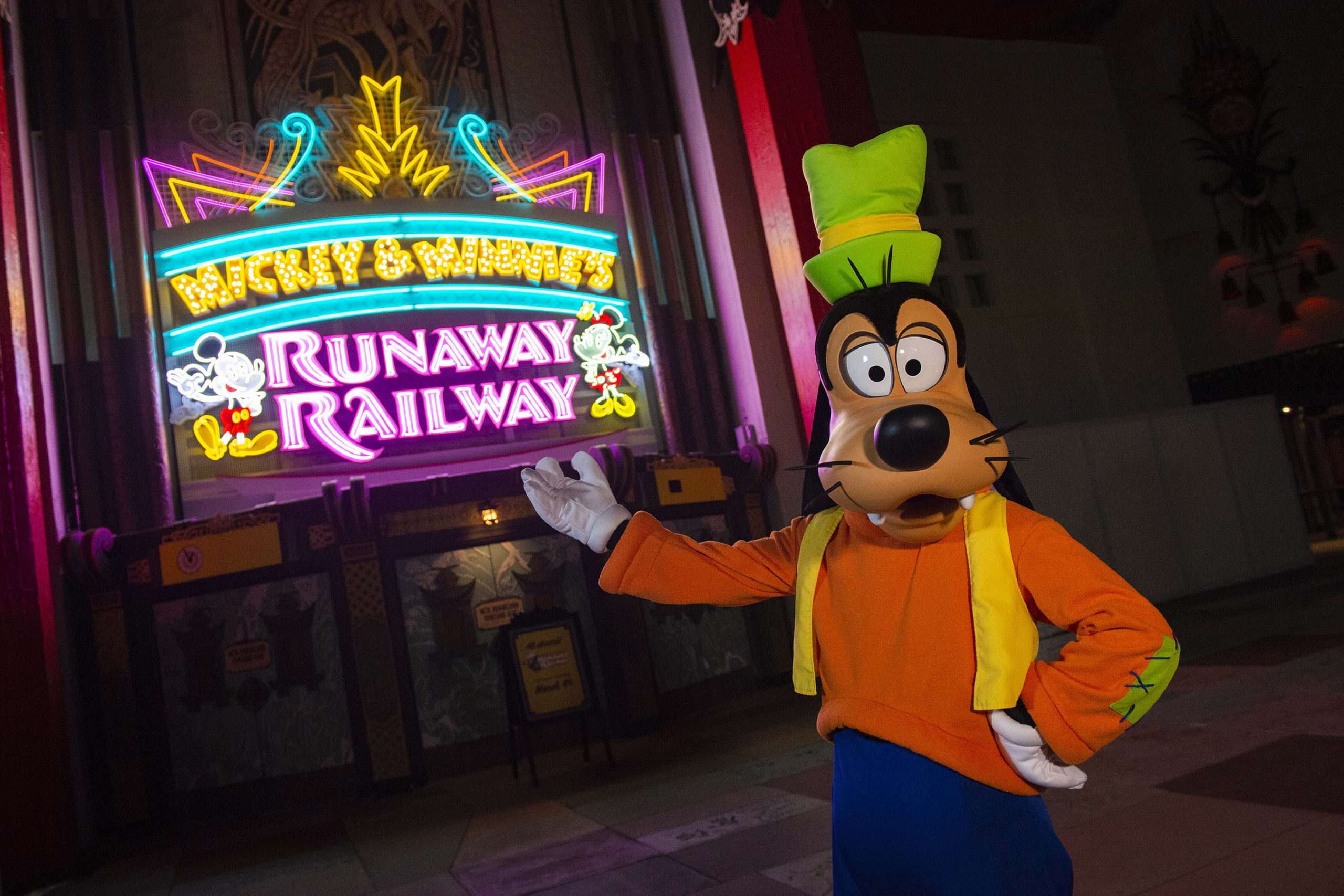 Goofy with Disney sign