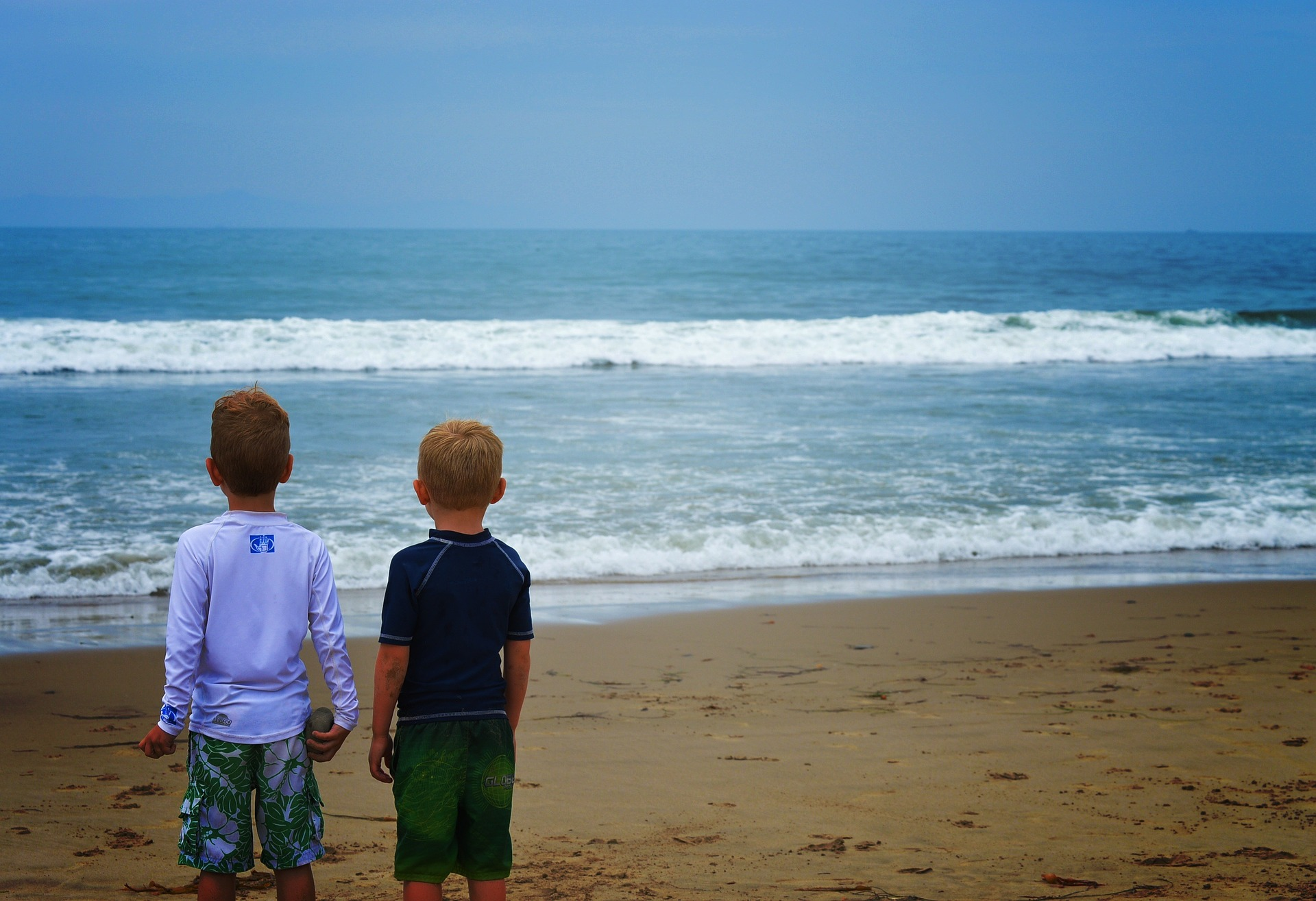 Two boys on the beach during a San Diego family vacation