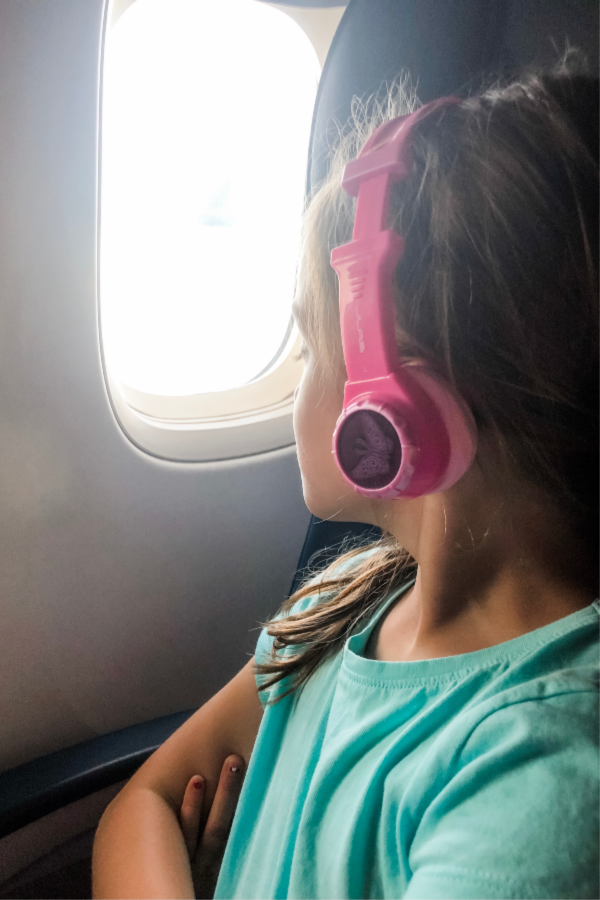 Your international packing list should include headphones to use on the plane.