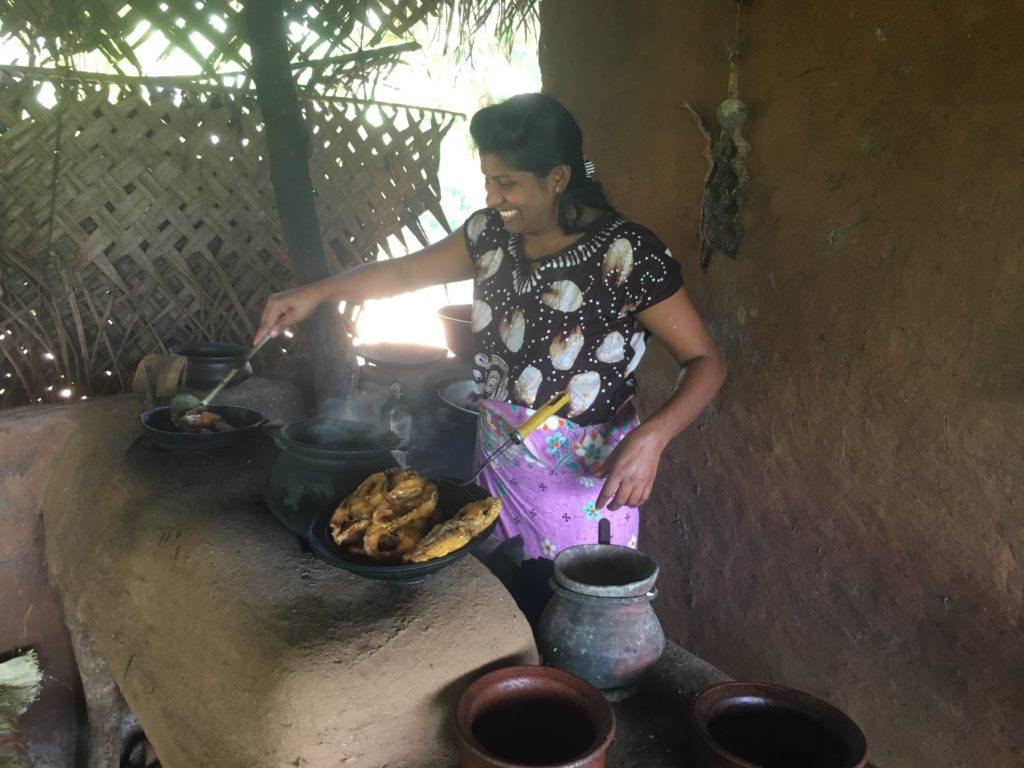 sri Lankan woman cooking a meal
