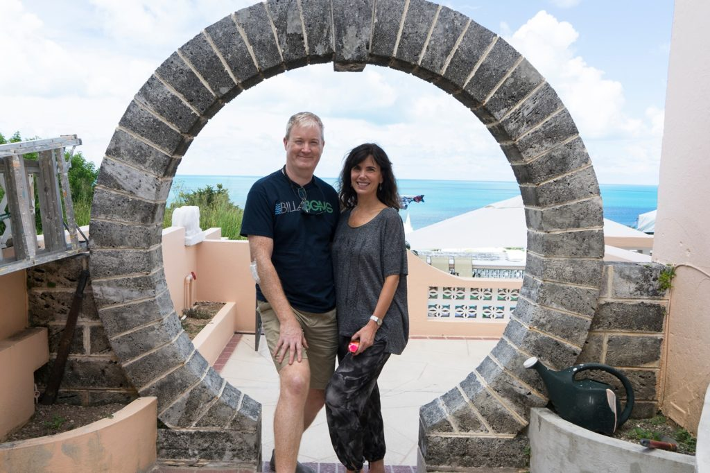 """A couple poses in a """"Moongate"""" in Bermuda"""