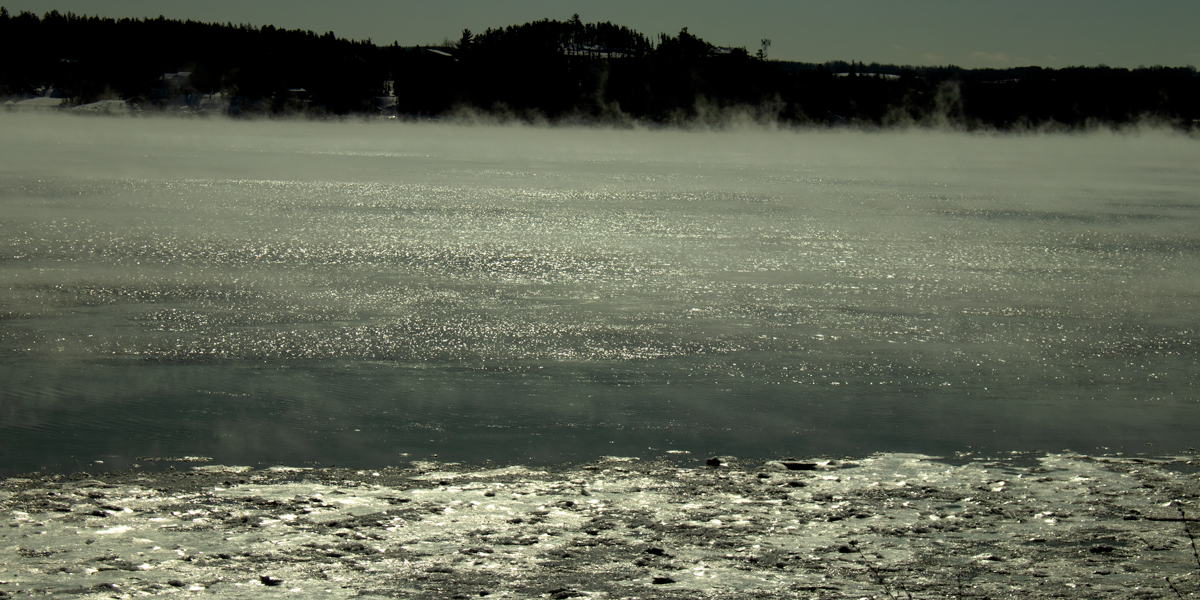 photo, fog rising from ice flows on Saguenay Fjord