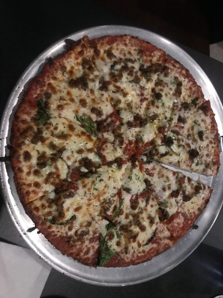Vegan pizza from Utah Station, one of the best St. Louis restaurants for families.
