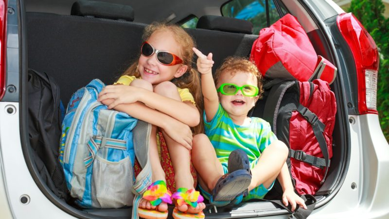 Road trip planner - get the kids involved. in the back of a large vehicle.