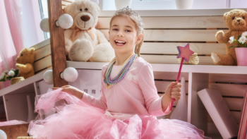 little girl in tutu wearing beads and a tiara