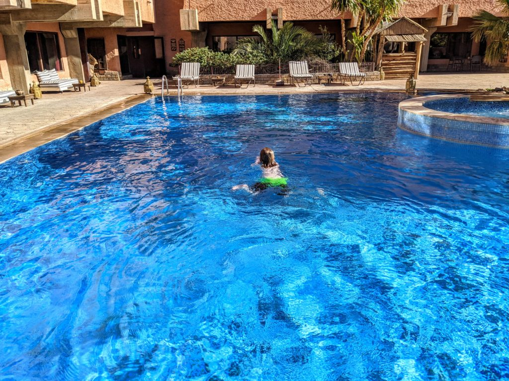 boy swimming in a pool in Morocco