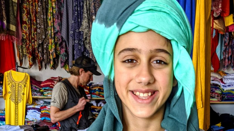 A boy in a traditional Moroccan head scarf.