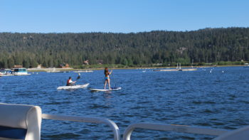 Paddleboarders on Big Bear Lake in summer