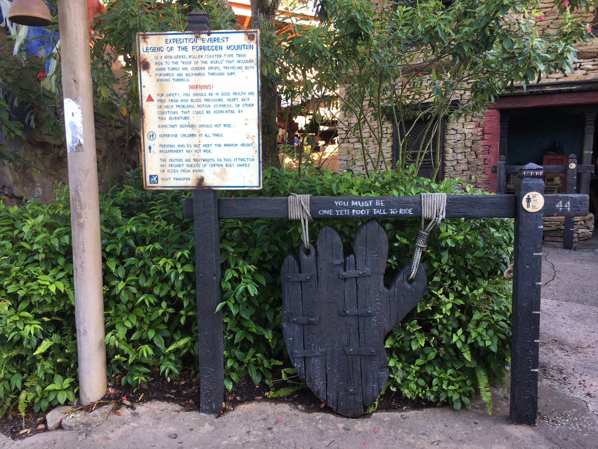 Disney World thrill ride Expedition Everest's theming continues all the way outside the ride on the height requirement sign which is shaped like a Yeti footprint!