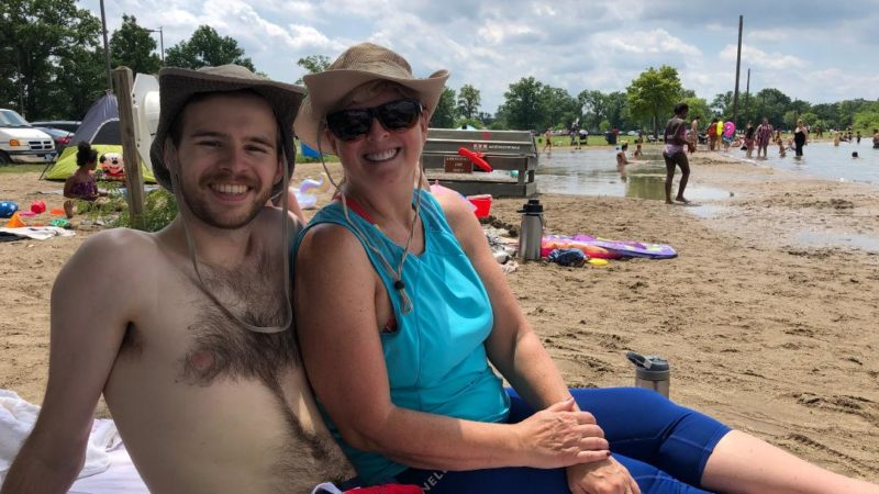 Mom and son at Belle Isle Beach in Detroit